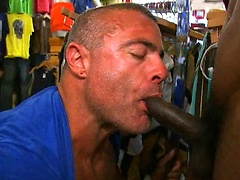 Mature hunk sucking off big black cock