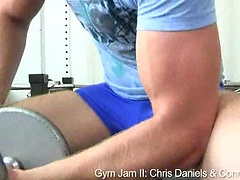 Horny hunks fuck in a gym