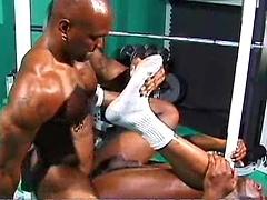 Ebony bodybuilders Flex Deon and Soloman fucking in a gym