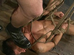Muscle hunk slaved by two men and fucked