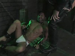 Dom Spencer Reed goes into the dungeon and finds slave dominic tied up. Spencer in full the leather works over naked dominic with a heavy flogger.