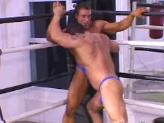 Bodybuilders wrestling
