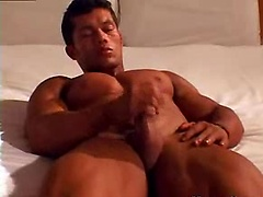 Angel plays with his latin cock