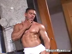 Mike strokes his muscled cock