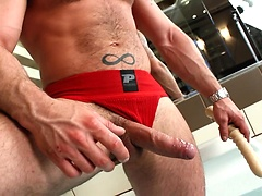 Hairy muscle man plays with dildo