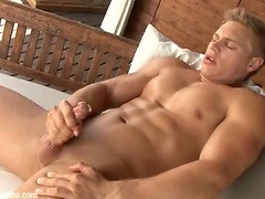 Hot blond jock Brady Jensen gets naked, shows off his cock and jerking off
