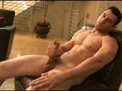 Muscle stud Nick Torretto plays with his cock