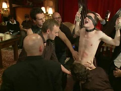 Partygoers beat and skull fuck a big dick stud in bondage.