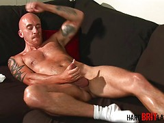 Bald british chav Sam Porter plays with his big uncut cock