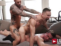 Dylan James and Alexander Volkov double-team Andrey Vic