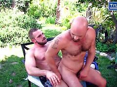 Hairy Bald Muscle Bear Sucks Cock outside