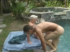 Three naked guys jump in the pool and have sex next to it
