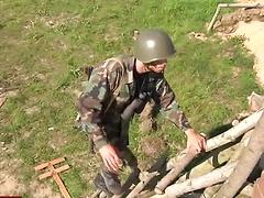 Soldier strokes stranger's cock