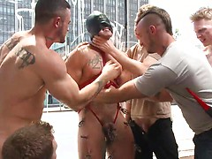 Muscled whore gets publicly fucked and doused with cum