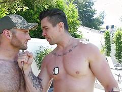 Hot muscle daddy rubs and oils up cute jock before sliding his thick cock in his tight ass.